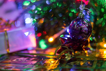 hristmas tree on abstract light bokeh background.