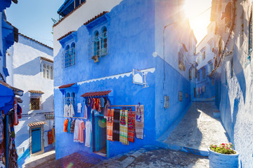 Blue building at Chafchuen at sunny day. Traditional Maroccan fabric store. Travel destination concept.