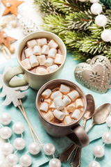Hot chocolates with marshmallows in Christmas setup