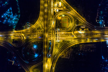 Aerial view light intersection on motorway highway at night