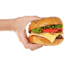 Female hand with tasty burger on white background