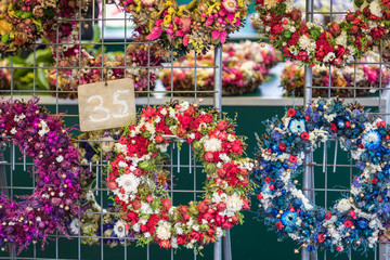 Christmas flowers wreaths decorations in Cracow Christmas market in Poland.