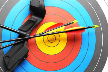 Target with bow and arrows for archery, closeup