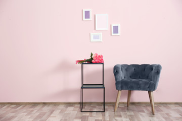 Modern interior with armchair on pink wall background