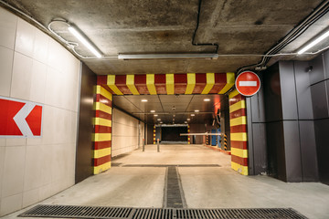 Departure from Underground garage or modern car parking and road sign stop