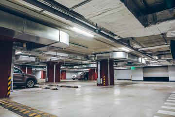 Underground garage or modern car parking,  industrial interior