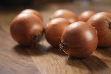 brown onions on old wood table