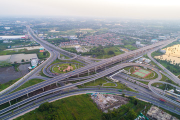 Overpas traffic intersection road topview with green tree in the morning
