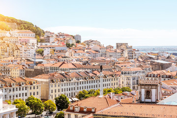 Cityscape view on the old town with Pedro IV statue in Lisbon city, Portugal