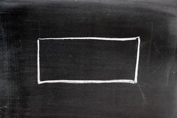 white chalk drawing in blank square shape on blackboard background