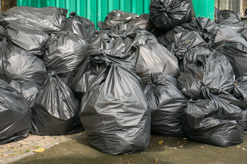 Garbage bags and garbage bins