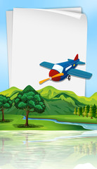 Paper template with plane flying over river