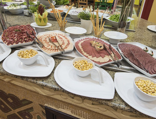 Selction of cold meat salad food at a restaurant buffet