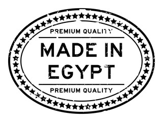 Grunge black premiumq quality made in Egypt oval rubber seal business stamp on white background
