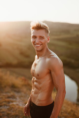 Smiling bare-chested man