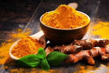 Canvas Prints Spices Composition with bowl of turmeric powder on wooden table
