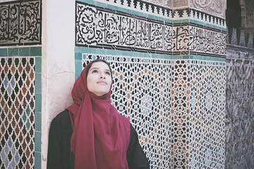 Arab woman in traditional clothing with red hijab on her head