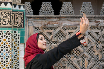 Arab woman in traditional clothing taking selfie