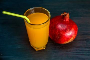 oranges and orange juice on a wooden dark background