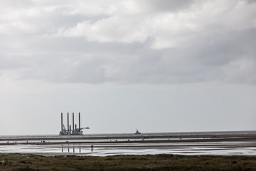 Tuc with the construction platform in the north sea