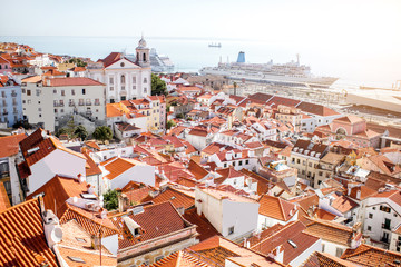 Cityscape view on the old town in Alfama district during the sunny day in Lisbon city, Portugal