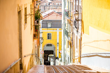 Street view with famous funicular tramway in Lisbon during the sunny day in Portugal