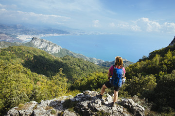 female hiker with daypack on the amalfi coastal trail / Salerno, italy, europe Wall mural