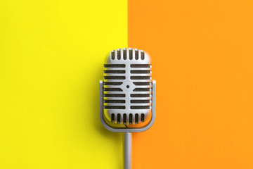 Flat lay of retro microphone.