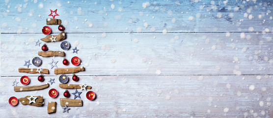 Christmas tree and snowflakes on wooden background  -  Flat lay, Panorama, Banner