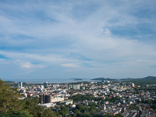 cloudy blue sky background and cityscape from the viewpoint on hilltop