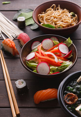 Asian food on wooden background, copy space
