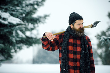 christmas man with beard hold axe in winter forest