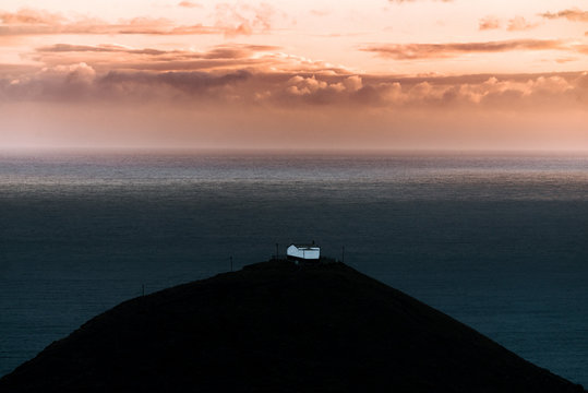 Lonely house by the sea on Madeira Island, Portugal during sunset