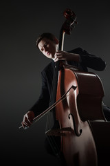 Wall Murals Music Double bass player contrabass playing with bow