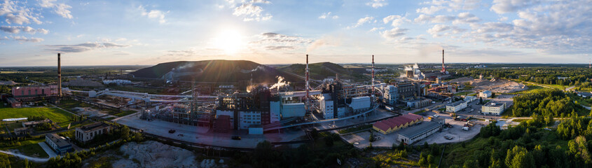 Aerial view Oil refinery with a background of mountains and sky at sunset. Aerial panorama.