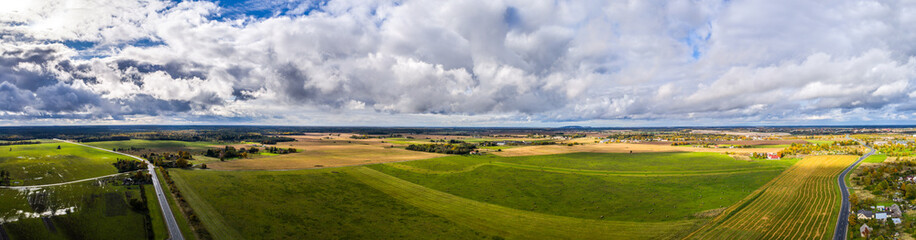 Aerial view of wheat fields. Countryside aerial landscape. Panorama.