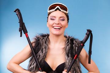 Sexy woman holding ski poles