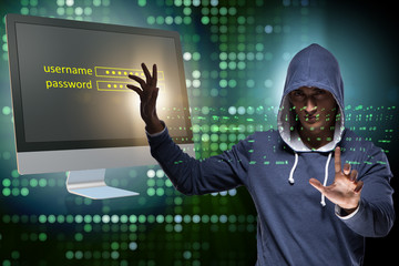 Hooded hacker in data computer security concept
