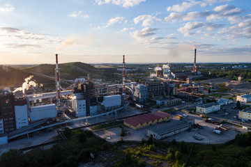 Aerial view Oil refinery with a background of mountains and sky at sunset. Aerial photography. Kohtla-Järve city, Estonia, Ida-Virumaa.