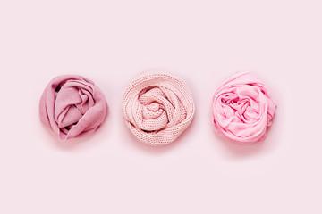 Warm winter scarf. Arrangement in pastel pink colors.