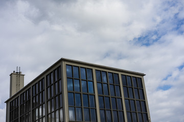 modern square building with cloudy sky
