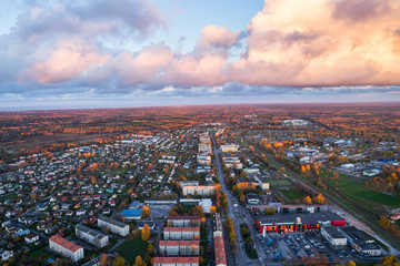 Aerial view of the city at sunset. Beautiful autumn city landscape.