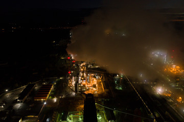 Aerial view of oil refinery. Industrial view at oil refinery plants with lots of light at night.