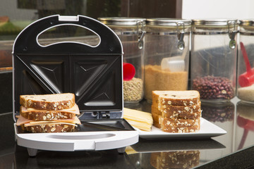Open Sandwich Toaster with ingredients in a kitchen setting