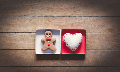 Gingerbread man and heart shape toy in boxes