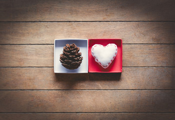 Pine cone and heart shape toy in boxes