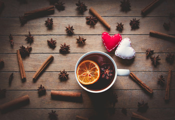 Two hearts and cup of tea with cinnamon and star anise