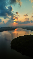 aerial shot of island in tropical lake at sunrise sri lanka