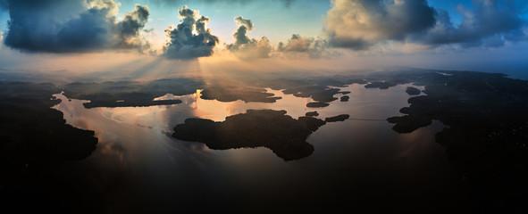 aerial panorama shot of islands in tropical lake at sunrise sri lanka