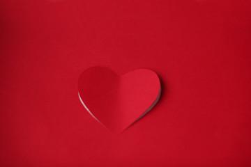 Heart cut in paper background
